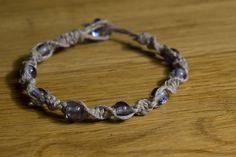 Gray hemp bracelt w/glass beads. $6.00  Email me for more info: dkwilson68@hotmail.com