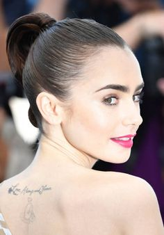 British actress Lily Collins poses on May 19 2017 during a photocall for the film 'Okja' at the 70th edition of the Cannes Film Festival in Cannes...