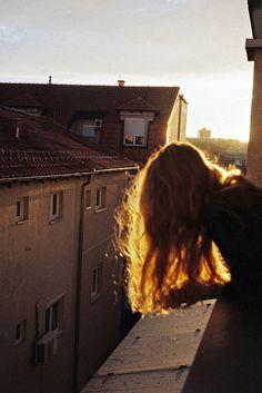 Sunshine bathed her warm, brown hair.