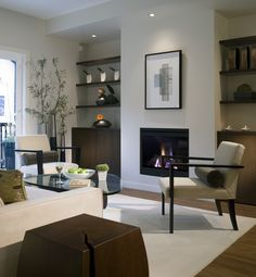 It's hard to imagine that this fireplace used to have brick on the exterior. Great new design. #fireplace #remodel #homeremodeling