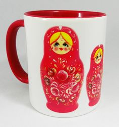 Russian Doll (Matryoshka) Ceramic Mug by Half a Donkey, showing a set of 5 Russian (Matryoshka) Nesting Dolls resplendent in red. The mug has a red inner and red handle Designed and printed in Britain. A high quality ceramic mug which is dishwasher proof. Height is 9.5cm, diameter 8.2cm, with a capacity of 310 ml (11oz). From the Series 1 Original Line Range by Half a Donkey Ltd. www.halfadonkey.co.uk