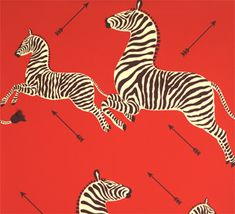 "Scalamandre ""Zebra"" pattern wallpaper.    The iconic Zebra pattern dates to late 1930s New York, premiering at Gino's restaurant on Lexington Avenue. Flora Scalamandre designed the art deco wallpaper especially for its shoe-boxed sized premises, styling zebras with arrows representing a hunt. Also seen in Wes Anderson's ""The Royal Tenenbaums."""