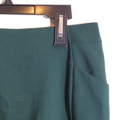New Short Dark Green Skirt New with tags, short dark green skirt, little pockets in front, zipper in back, slit opening in the bottom of the back, H&M, size 8 H&M Skirts
