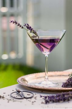Gorgeous lavender martini as a signature wedding cocktail! (via Colin Cowie Weddings) Lavender Martini INGREDIENTS: Ice 1 1/2 ounces vanilla vodka 1/2 ounce fresh lemon juice 1/4 ounce Lavender Syrup (Check my pins for recipe) 1 fresh lavender sprig DIRECTIONS: Fill a cocktail shaker with ice. Add the vodka, lemon juice and Lavender Syrup and shake well. Strain into a chilled martini glass and garnish with lavender stems