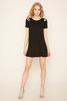 Forever 21 Contemporary - A short-sleeved knit dress featuring crisscross cutout accents at the back and shoulders.