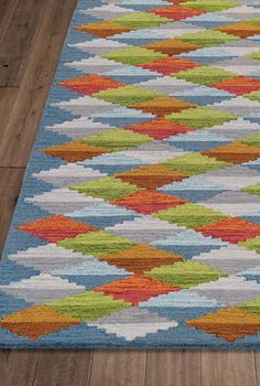 Some rugs are mere backdrops – the Facet Rug makes a strong statement of its own. And it's worthy of a lingering look, since its dense pattern almost seems alive!