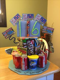"16th birthday ""cake"" for boy. Pringles, soda, cookies, lotto tix, origami dollars, candy. Easy to assemble!"
