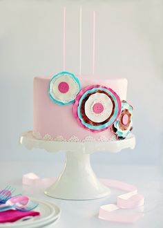 pink cake with cute rosettes