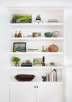 Styling Bookshelves | You know I love green! Paired with the warm wood accents is so good.