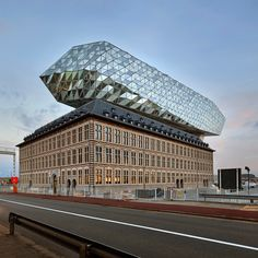 Zaha Hadid Architects sits glass lump on top of Antwerp port building : 10 architecture and design projects that feature faceted surfaces Zaha Hadid Architecture, Architecture Cool, World Architecture Festival, Organic Architecture, Residential Architecture, Contemporary Architecture, Parasitic Architecture, London Architecture, Chinese Architecture