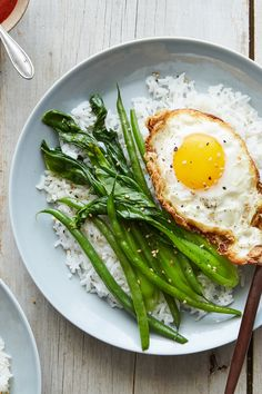 NYT Cooking: Coconut oil toasts rice grains, lightly coats vegetables, and sizzles eggs in this dish, lending its unique tropical taste and richness. - Coconut About Egg Recipes, Cooking Recipes, Healthy Recipes, Healthy Eats, Healthy Foods, Coconut Rice, Toasted Coconut, Rice Grain, Roasted Salmon