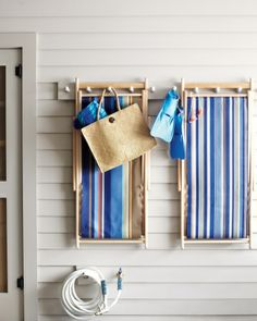 Painted Shaker racks make attractive drying pegs for outdoor chairs and beach towels.