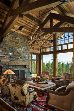 Locati Architects - love the beams, ceiling and big windows in the great room/living room.