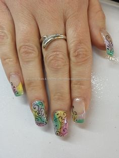 Multicoloured pastel gel polish with freehand swirl nail art