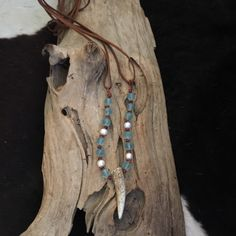 Great looking piece for layering! I can't get enough of these naturally beautiful antlers. Paired with sea glass and deerskin leather, makes for a unique piece of boho chic jewelry! MADE TO ORDER IN Y