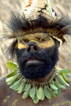 A grotesquely made up warrior at Mount Hagen Sing-Sing, Papua New Guinea