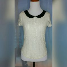 """CREAM LACE SHIRT Size XS. Cream/black. Peter pan collar. Lace. Short sleeve. Single button key hole closure. Length : 20"""". 93% Nylon/7% Spandex. Excellent Used Condition. American Eagle Outfitters Tops Blouses"""
