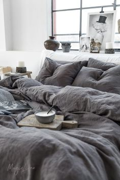 Linen duvet cover in charcoal gray (dark gray) color. Perfect for unisex bedroom decor and easy to mix and match with other colors and patterns.