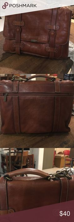 Leather briefcase Leather briefcase great condition multiple pockets and storage. The handle attachment was replace with a hook on one side as shown in picture Bags