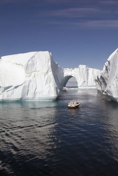 Icebergs in Disko Bay, Natural arch Ilulissat, Jakobshavn, Greenland ~ UNESCO World Heritage Site.  Photo: Gabrielle Therin-Weise