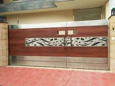 Hinged Brown Stainless Steel And Wooden Gate, Thickness: Material Grade: Rs 1200 /square feet Modern Front Gate Design, Home Gate Design, House Main Gates Design, Gate Designs Modern, Steel Gate Design, Iron Gate Design, Main Door Design, Staircase Railing Design, Stainless Steel Gate
