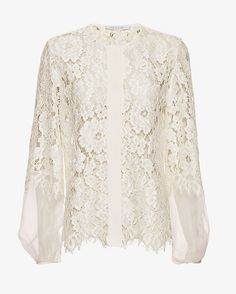 Alexis Organza Lace Blouse: Organza & lace makes for one of the prettiest statements on this long sleeve blouse. Button placket. Covered button cuffs. Sheer. In white.   Fabric: 46.2% nylon/24.3% rayon/15.6% modal Combo: 100% silk Made in China.    Model Measurements: Height 5'11; ...