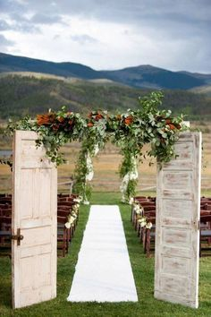 Mountain Wedding With White Wooden Old Doors, And Beautiful Backdrop // 10 Rustic Old Door Wedding Decor Ideas For Outdoor Country Weddings