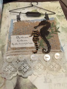 Sizzix Tim holtz seahorse die cut burlap mixedmedia distress paint lace buttons recycled cloths lace buttons by the sea textile art fabric art