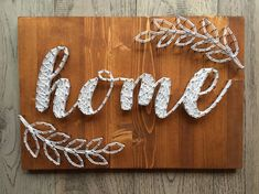 "Made to order, handcrafted ""Home"" string art wall sign. Constructed on solid pine. Dimensions are approx 15""x12"". Pictured is Tuscan stain with bright white string. Other stain options are Chocolate, Weathered Grey, or Antique Aqua. String options are endless! Just let me know what"