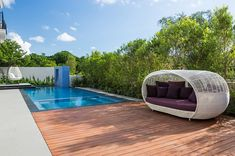 An outdoor canopy bed that can be moved around with ease homesthetics Stylish and Fashionable Outdoor Beds For The Ultimate Backyard Lounge . Outdoor Daybed, Outdoor Seating, Outdoor Spaces, Outdoor Living, Outdoor Furniture, Outdoor Decor, Modern Furniture, Outdoor Swimming Pool, Pool Decks