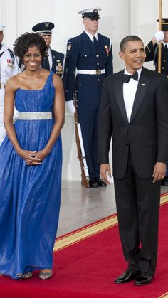 President Barack Obama and First Lady Michelle Obama await the arrival of the Mexican President Felipe Calderon and Mrs. MargaritaZavalato this evenings State Dinner at the White House. Photos taken on May 19, 2010 in Washington, DC. Photo Credit: Marvin Joseph, The Washington Post via Getty Images  via @AOL_Lifestyle Read more: http://www.aol.com/article/2014/01/17/michelle-obama-turns-50-see-her-best-style-moments/20810403/?a_dgi=aolshare_pinterest#fullscreen