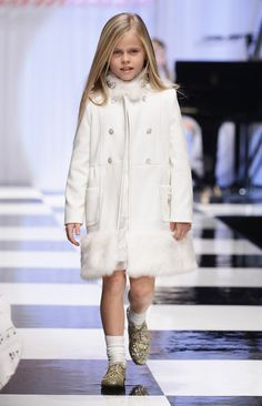A young girl walks the runway of the Miss Blumarine fashion show as part of Pitti Immagine Bimbo 74 on January 19, 2012 in Florence, Italy.