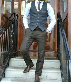 Dark olive trousers navy blue vest sky blue shirt dark brown brogues