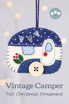 A vintage caravan trailer hanging ornament, handmade from felt and decorated with fabric scraps. With tiny felt bunting and buttons for the wheel and door knob.Colors are vintage blue and cream.A perfect Christmas ornament for a caravan owner.The ornament is flat in shape, with a plain felt back and has a loop for hanging.Approx 3 x 2.5 inches / 7.5 x 6.5 cm. The price includes worldwide shipping. #feltchristmasornaments #feltornaments #vintagecamper #vintagetrailer #vintagecaravan Scandi Christmas, Vintage Christmas, Xmas, Felt Christmas Ornaments, Hanging Ornaments, Felt Bunting, Vintage Caravans, Handmade Felt, Felt Art