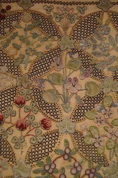 Details of the embroidery on a cushion cover worked by Annie Eastwood linen ground, wool and silk threads c.1922