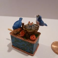 Jean Rohall - mechanical toy; birds feeding their young; turn the handle and the chicks move; 1996