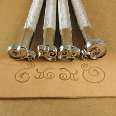 New in my shop! These are a fun way to decorate leather wristbands. Scrolls Leather Stamp Set - Set of Four - $35.00