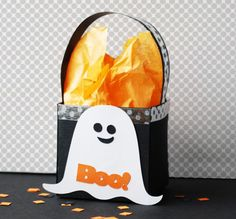 Paper craft tutorial teaching how to make a square ghost Halloween treat bag/box.