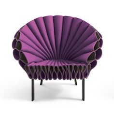 The Peacock Chair is created out of three single sheets of felt and a minimal metal frame. by Dror