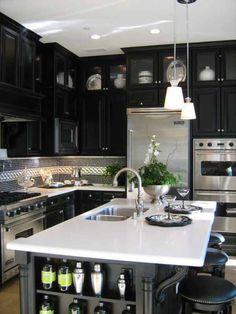 Black cabinets white counter, silver appliances