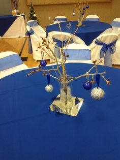 Royal Peacock Feathered wedding with the natural branches holding silver and royal blue glittered balls