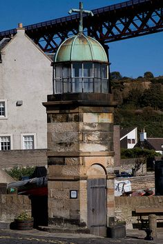 North Queensferry Light Tower - the world's smallest working Light Tower sits on the Town Pier, North Queensferry, Fife, Scotland