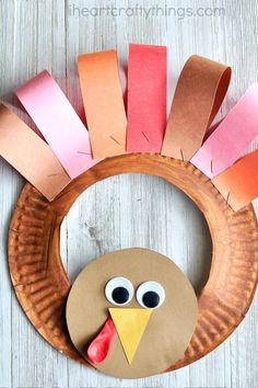 If your kids love helping you decorate for the holidays they are going to love making this adorable paper plate Thanksgiving turkey wreath. Fun Thanksgiving kids craft, turkey craft for kids and thanksgiving diy. (fall crafts for kids wreath) Daycare Crafts, Toddler Crafts, Fun Crafts, Crafts Toddlers, Fall Crafts For Preschoolers, Crafts Cheap, Paper Plate Crafts For Kids, Creative Crafts, Thanksgiving Crafts For Kids