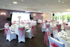 Large crystal globes and dusty pink sashes add colour for this special occasion.  Available to hire from Make It Special Events, Atherstone