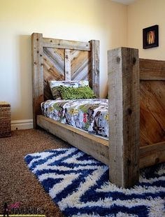 Rustic chevron twin bed plan made from reclaimed barn wood on http://Hertoolbelt.com Free plans!