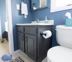 Completely update your bathroom with this cabinet painting tutorial. This series will show you how to do a complete bathroom makeover on a budget! Paint and stencil your bathroom tile! This is the ultimate bathroom makeover on a budget! Painting Bathroom Cabinets, Bathroom Mirror Cabinet, Mirror Cabinets, Diy Cabinets, Bathroom Furniture, Bathroom Storage, Small Bathroom, Bathroom Vanities, Storage Cabinets