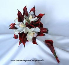Sharon Nagassar designs silk, latex, real touch, custom wedding flowers - Red Burgundy Calla lilies and white off-white Cymbidium orchids  These flowers make a gorgeous bouquet for a winter wedding! The price from this designer is $158.00, but if you're any good at do it yourself, you could make it yourself.
