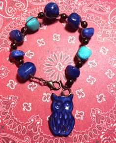 """Hooty hoo"" bracelet. Handmade with waxed irish linen thread, glass pearls, ceramic owl from White Clover Kiln, and stones from Michaels."