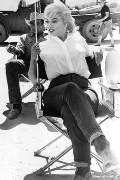 Marilyn Monroe with Montgomery Clift in the background on the set of The Misfits 1960