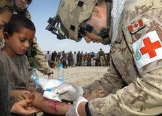 100 Images From Afghanistan - Day 57. A Romanian Patrol accompanied by Romanian Medical staff and Canadian medical staff stops at the town of Gang Kalacheh about 3 Km south of Kandahar, to administer medical treatment to local Afghans.